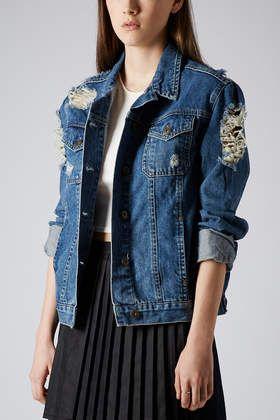 Topshop. http://us.topshop.com/en/tsus/product/clothing-70483/jackets-coats-2390895/moto-ripped-denim-jacket-2635626?bi=1&ps=200
